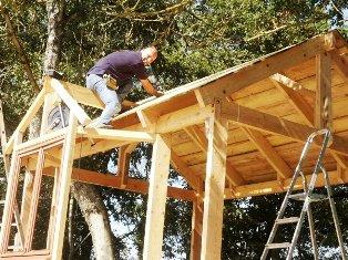 arnaud building the tree house
